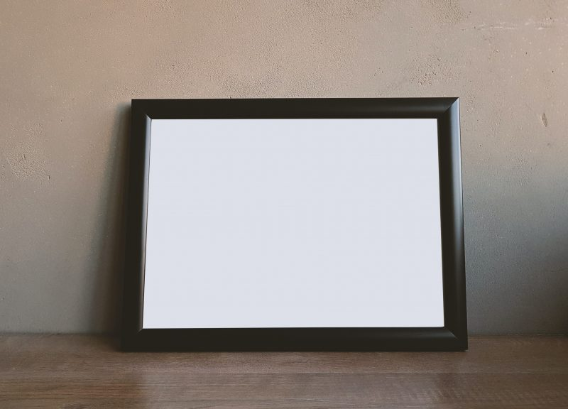 A photo frame that has thunder bugs.